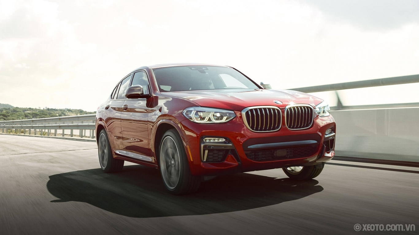 BMW X4 2020 hình ảnh ngoại thất Showcase the dominant style of the BMW X4 with distinctive double kidney grille and air intakes.